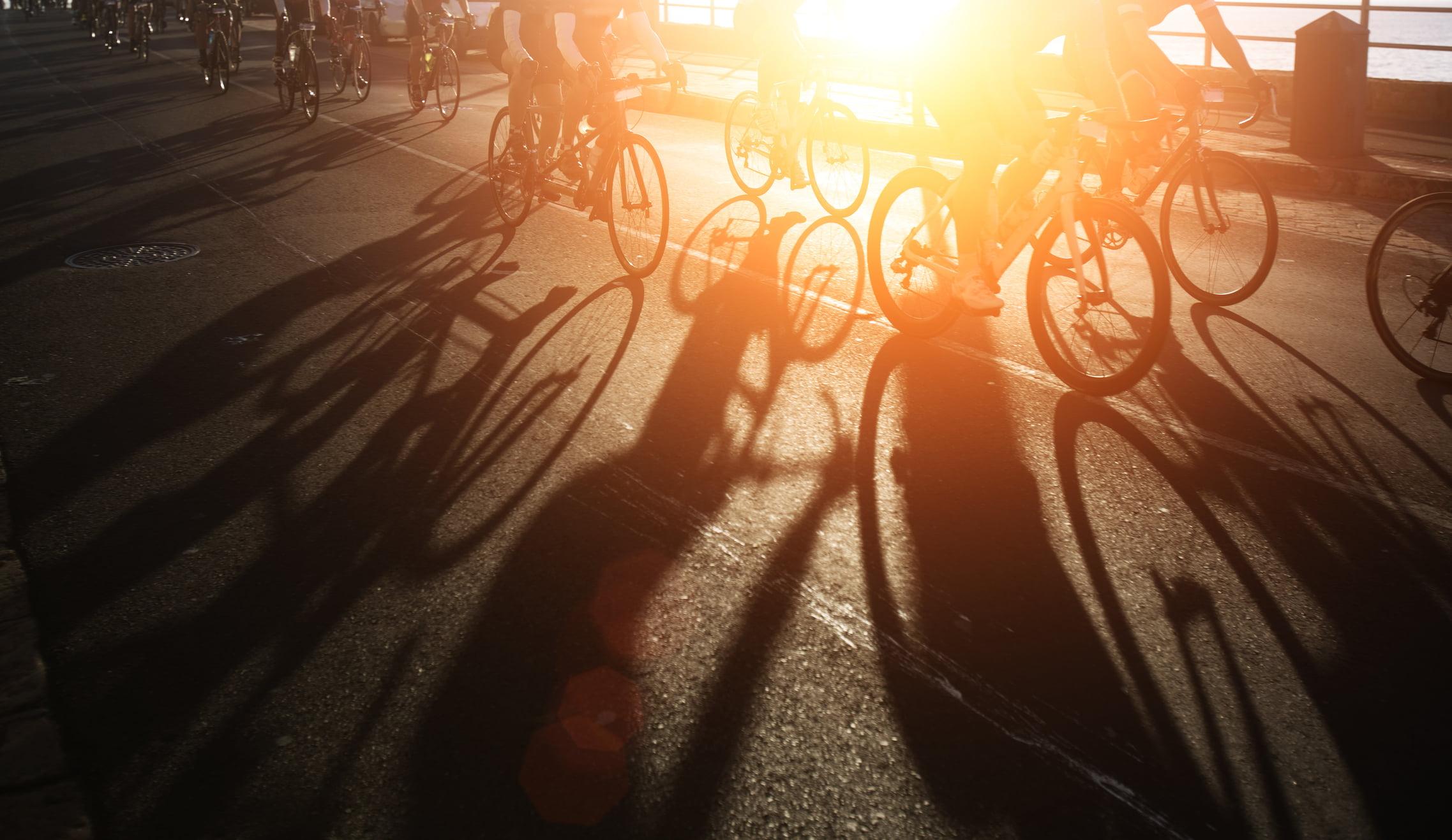 Shadows of bike riders at dawn