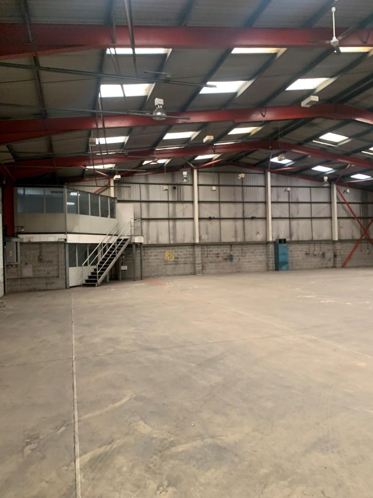 The warehouse underwent an extensive overhaul to upgrade it from its former condition (above) to an as-new standard.